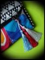 Multicolored bag clutch triangle print - blue details