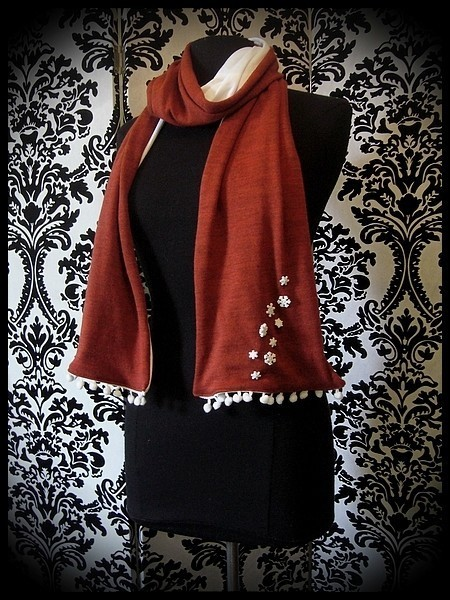 Burnt orange scarf white lining snowflakes buttons