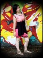 Pink mini skirt with black drape detail - size S/M